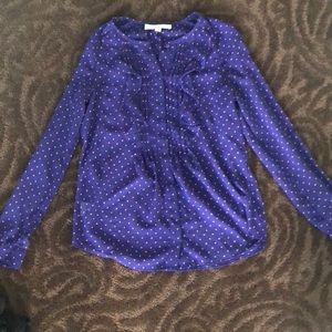 Purple ruffled blouse with stars